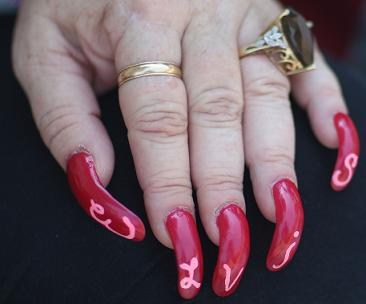 Shirley Roberts of Memphis, Tennessee shows her Elvis nails
